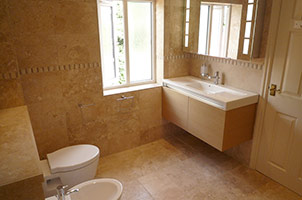 Wet Room with Corner Jacuzzi Bath.