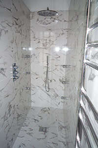 Wet Room with 6-Jet Recessed Shower.