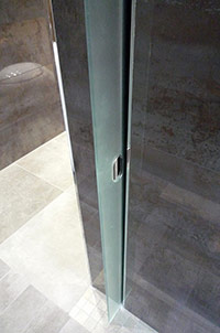 Post-Modern Wet Room with Internal Sliding Glass Toilet Door.