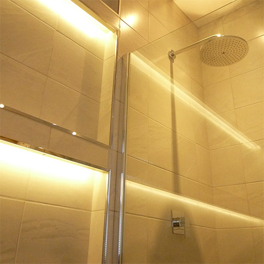 Shower head and integrated lighting